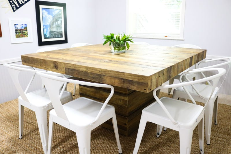 wooden table with white chairs