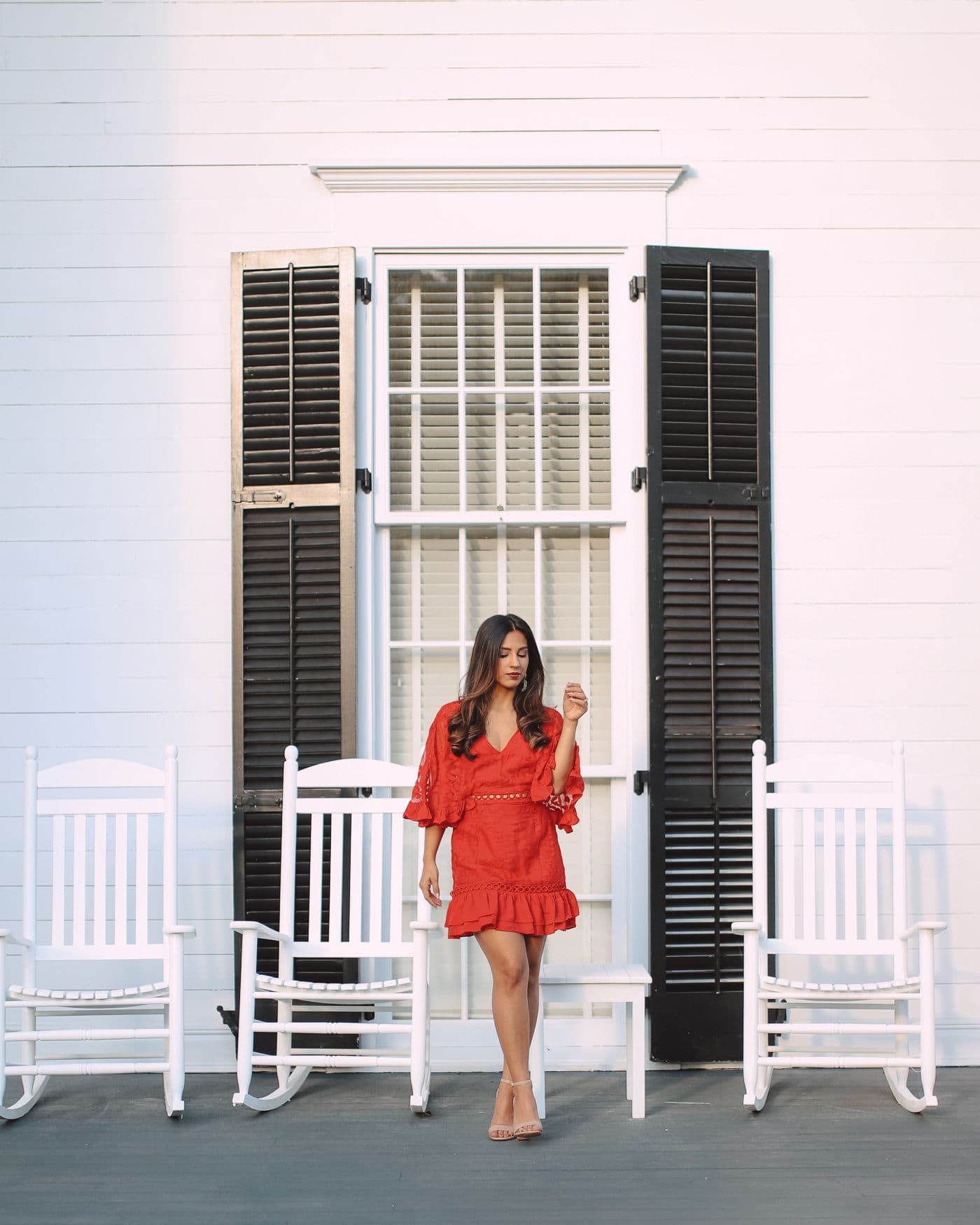 Sabrina standing in front of a window