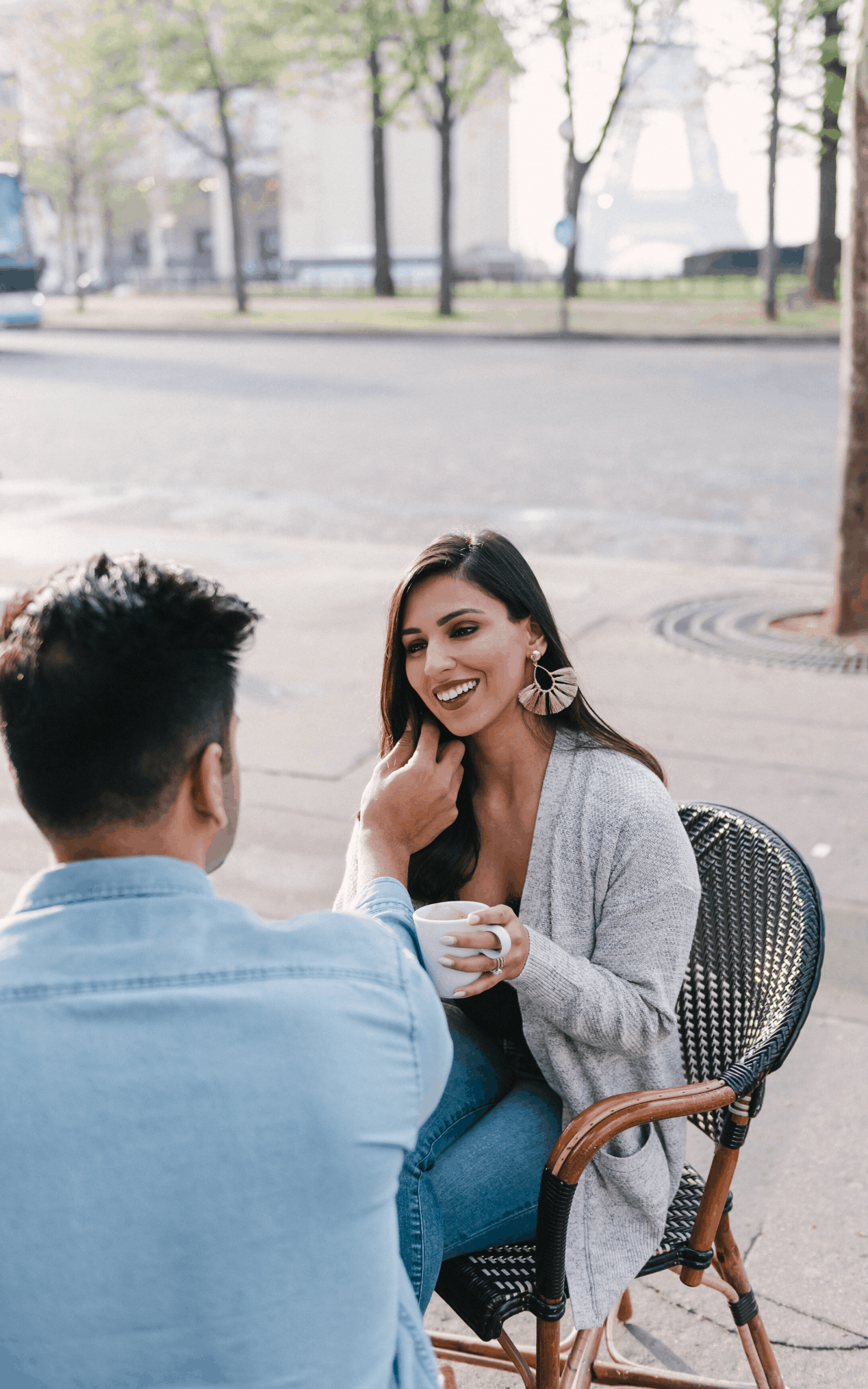 man and woman on a date at an outdoor cafe